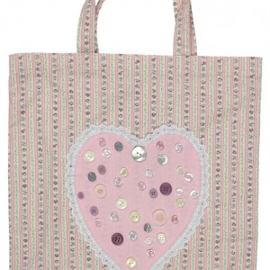 A photograph of the pink shopping bag showing the appliqué heart and handles.