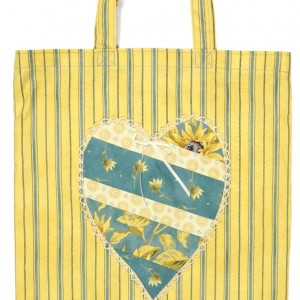 The yellow shopping bag with appliqué detail.