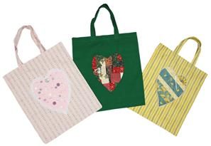 The photograph shows three versions of a simple traditional fabric shopping bag.  The colours of each bag are predominantly pink, green and yellow.