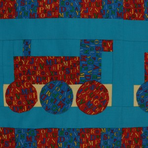 A detail of the Choo Choo quilt showing the locomotive.