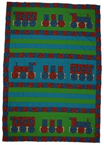 Shows a childs' quilt based on a train design.  the main colours are bright red, green and blue.