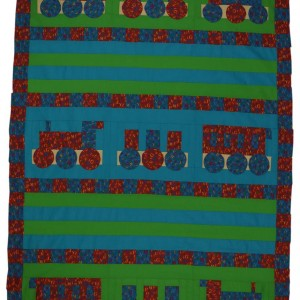 Shows the Choo Choo quilt which is based on a toy train design. The colours are bright blue, red and green.