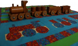 A photograph of the toy wooden train that inspired the quilt design.