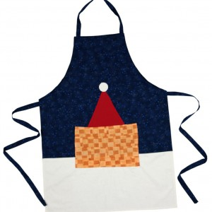 A blue and white patchwork apron project for christmas. It has a red Satan hat and a useful patch pocket.
