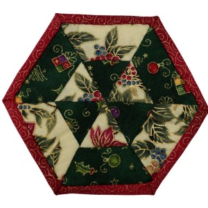 One of six Christmas coasters. This one has a pleasing triangular pattern in the centre surrounded by cream and green panels and a red border.