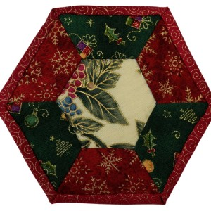 One of six Christmas Coasters. This one has a cream center piece surrounded by green and red panels.