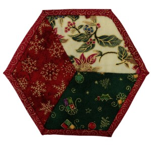 One of six Christmas patchwork coasters. This one is made from three diamond shapes inside a red border.