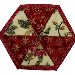 One of six Christmas coasters. This one consists of six cream and red triangles inside a red border.