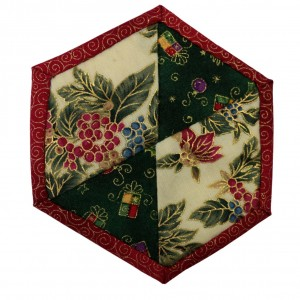 One of six patchwork Christmas Coasters. This one has triangular and Diamond shapes inside a red border.