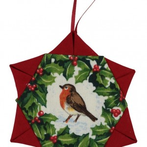 One of three Christmas tree decorations. This one is a star shape with a robin red-breast in the center, surrounded by a holly wreath.