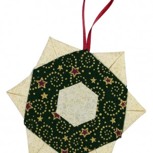 One of three Christmas tree decorations. This one is a gold coloured star with green detailing.