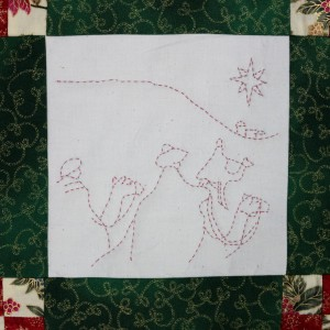 One of four panels on the Christmas wall-hanging. A Star is seen in the East.