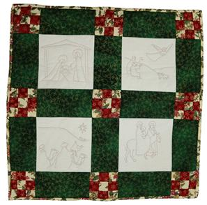 Shows a square quilted patchwork wall-hanging picked out in in traditional red and green colours for Christmas.  Christmas scenes are quilted on four light coloured panels.