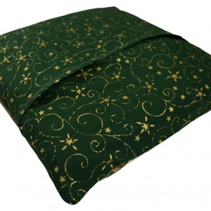 The rear side of the jockeys cap cushion cover which is finished in green with some printed gold decorative detailing.