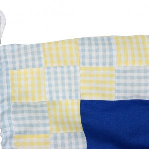 Shows a detail of the laundry bag including the drawstring know and top lefthand side of the appliqued panel.
