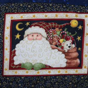 A view of the printed Father Christams image at the center of the log cabin table-mat