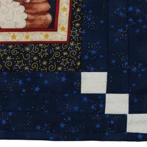 A detail of the table-mat showing the make-up of one corner. The radiating white patches are visible.