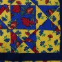 Close-up detail of Ohio Star Tablecloth showing four panels.