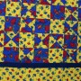 A detail of the Ohio Star Tablecloth showing approximately nine panels and a section of the border.