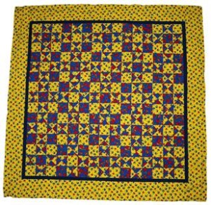 A pattern to enable you to make a brightly coloured and bold patterned tablecloth.  This one is mostly red and blue on a yellow background.
