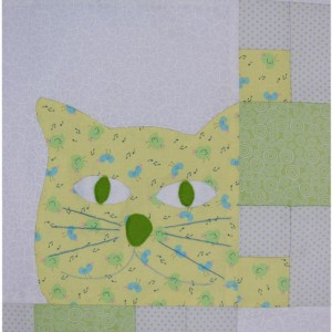 This shows one panel of the Puss In The Corner quilt where the cute kittys' face is visible.