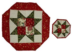 A Sawtooth Star tablemat and coaster. The colours are chosen to be suitable for Christmas being mainly red, green, cream and gold.