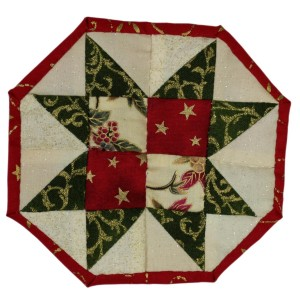 This is the sawtooth coaster in green, cream and red for Christmas. It has eight sides and a red border.