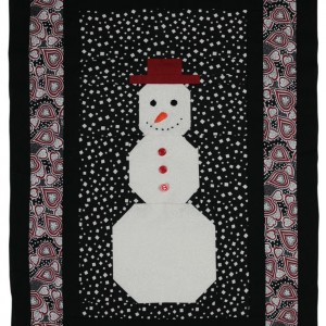 The Snowman panel with the white snowman at the centre surrounded by a black and red border.
