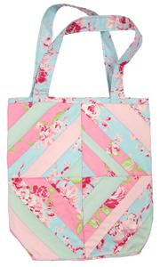 Shows the sting pieced tote bag which comes in really cheerful colours; pinks, light blue and very light green.
