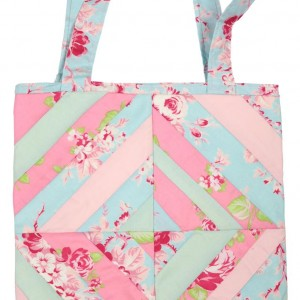The string pieced tote bag in pastel shades of pink, blue and green.