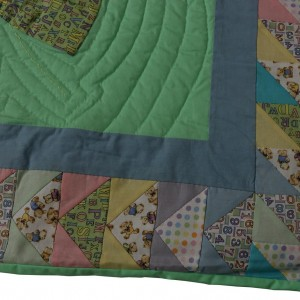 A corner detail of the balloon baby quilt showing the flying geese pattern.