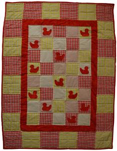 A full view of the ducklings quilt in bright and cheerful yellow and red.