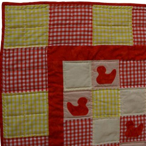 A detail of the Ducklings Quilt showing a typical area including parts of the border and edging.